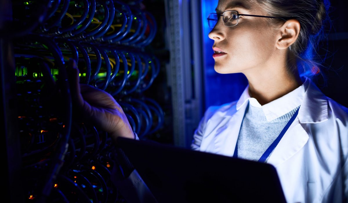 Female Computer Scientist Checking server